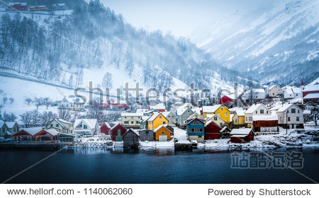 wooden houses on the banks of the Norwegian fjord  beautiful mountain landscape in winter