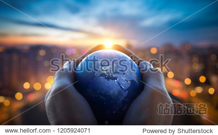 The globe Earth in the hands of man against the night city. Concept on business  politics  ecology and media. Earth day abstract background. Elements of this image furnished by NASA.