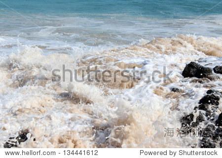 在桑迪海岸的印度洋海洋沙滩上西澳大利亚班伯里在一个晴朗的早上阳光