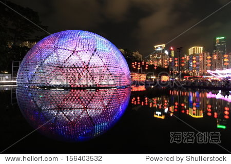 HONG KONG, CHINA - SEPTEMBER 16: Victoria Park dome lights up to celebrate the mid-autumn festival, also known as moon festival, on September 16, 2013 in Hong Kong, China.