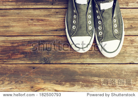 sneakers on wooden deck.