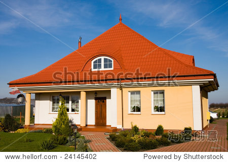 single family small yellow house against blue sky