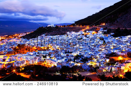 ��in9l$yi��d#9.�_chefchaouen medina at twilight morocco.