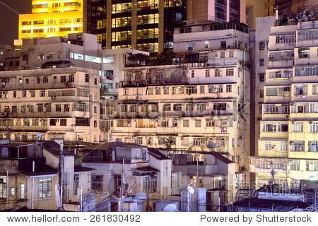 Apartment buildings at night in Hong Kong.