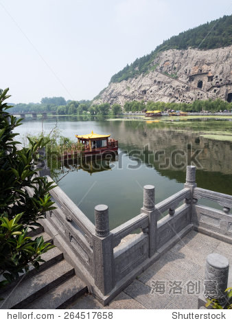 Stone pier and boat at Longmen Grottoes