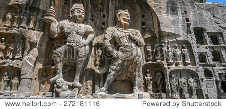 Carved Buddha images at Longmen Caves, Dragon Gate Grottoes, dating from the 6th to 8th Centuries, UNESCO World Heritage Site, Henan Province, China, Asia.