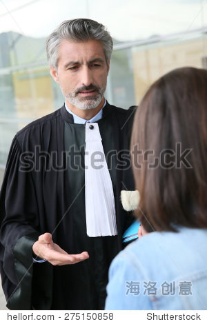 trial_lawyer meeting client in courthouse before trial