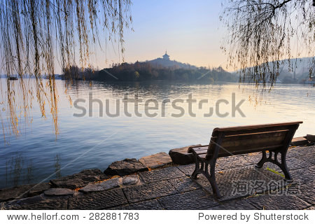 Wooden bench in park, Xihu Lake, Hangzou, China