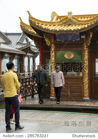 HANGZHOU, CHINA - MAY 3, 2015: Traditional Chinese wooden boat on the Xihu (West Lake). Locals and tourists visit the lake, which has influenced poets and painters throughout China.