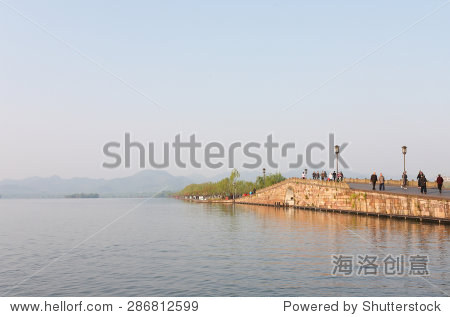 Hangzhou, China - April 12, 2015: Broken Bridge at West Lake Hangzhou, China. Broken Bridge is One of the Famous Scenic Sites at West Lake, also Called Xihu in Chinese.