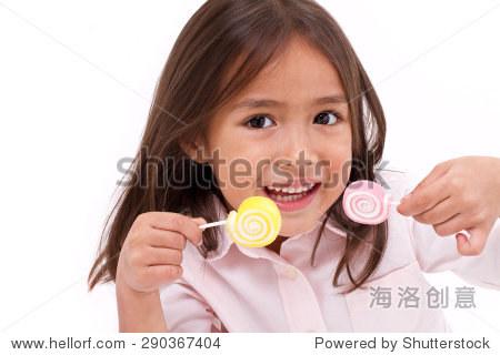 可爱的小女孩玩,吃糖果冻甜蜜的糖果