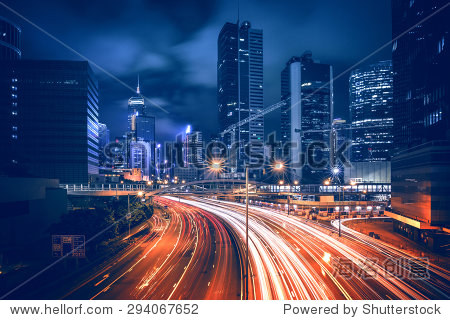HDR image of Hong Kong rush and busy traffic captured at night in central district - with vintage color tone tuned