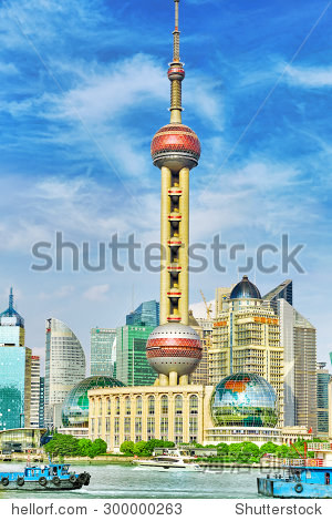 SHANGHAI-MAY 24, 2015. Oriental Pearl Tower on  blue sky background. Tower  470 meter the Oriental Pearl is one of Shanghai's tallest buildings, located at Lujiazui finance and trade zone in Pudong