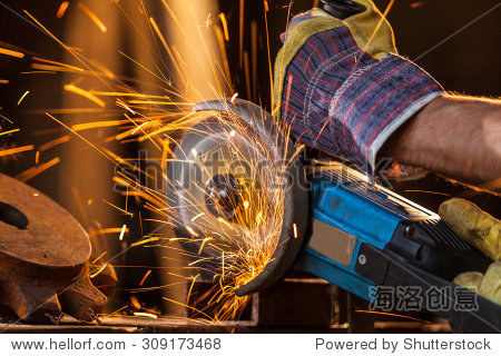 sparks while grinding iron. low depth of focus
