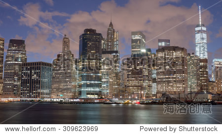 ��in9l$yi��d#9.�_skyscrapers in manhattan at night new york city