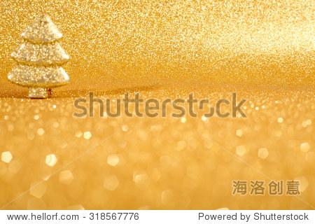 golden christmas fir tree decoration on glitter background