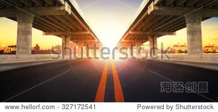 sun rising behind perspective on bridge ram for land transport and civil development