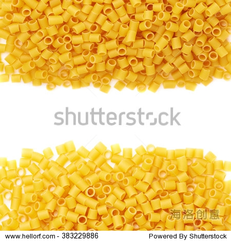 set of pile of dry ditalini yellow pasta over isolated white