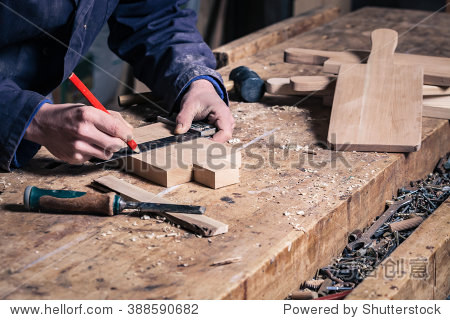 close-up of a carpenter working on a wooden