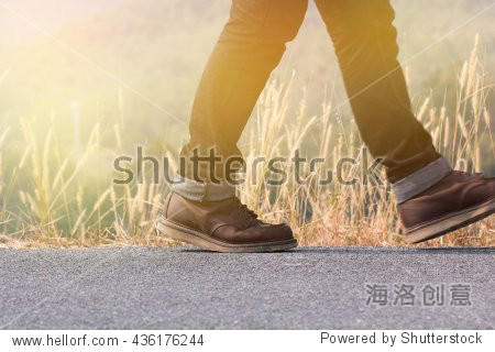 man walking on the road