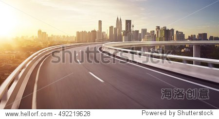 Highway overpass motion blur with city background . sunrise scene .
