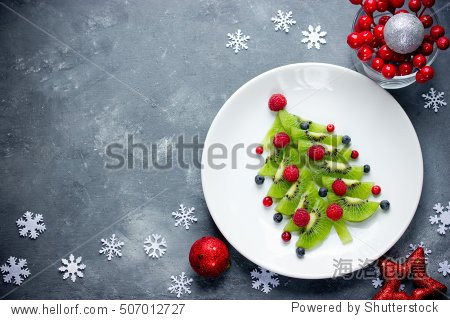 Funny edible Christmas tree, Christmas breakfast idea for kids. Beautiful Christmas and New Year food background top view blank space for text