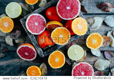 Fresh fruits. Mixed fruits background. Healthy eating, dieting. Background of healthy fresh fruits. Fruit salad - diet, healthy breakfast. pomegranate, persimmon, tangerine, banana, lemon