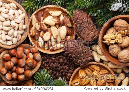 Various nuts on wooden table. Top view