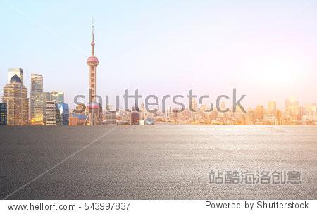 Empty road floor surface with modern city landmark buildings of Shanghai bund Skyline of morning