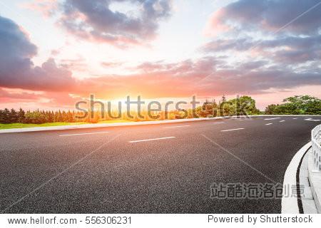 Beautiful rural asphalt road scenery at sunset