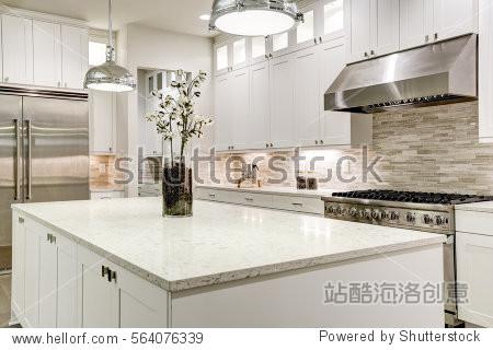 cabinets with marble countertops, stone subway tile backsplash