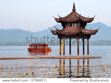 Chinese Xihu lake in Hangzhou with boat and arbor in morning