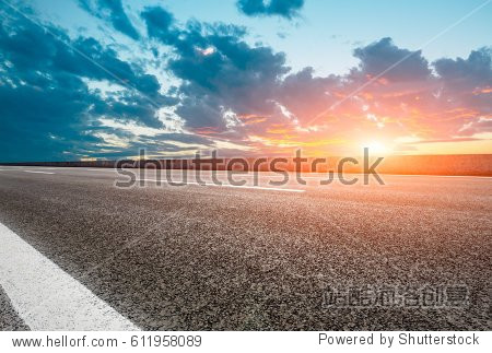 Asphalt road and beautiful sky at sunset