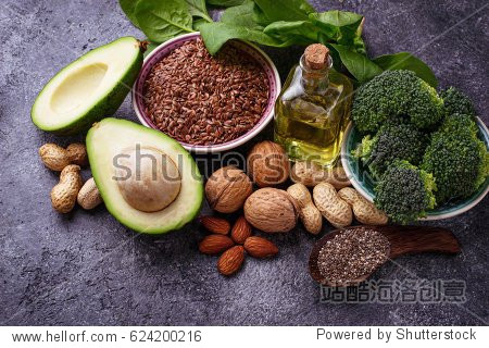 Vegan fat sources  flax, spinach, broccoli, nuts, olive, oil and avocado. Concept of healthy food