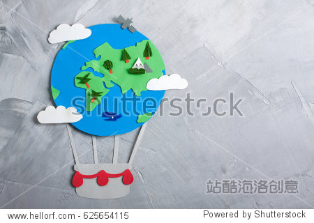 Paper craft earth globe handmade on gray concrete background. Earth day concept.