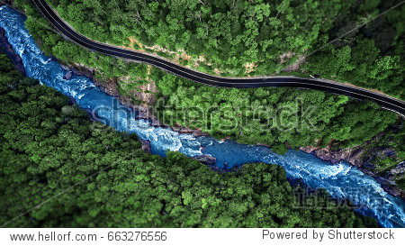 Mountain river and road aerial view