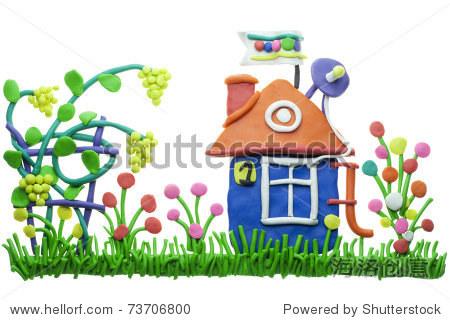儿童从橡皮泥拼贴.舒适可爱的家的概念.孤立在白色