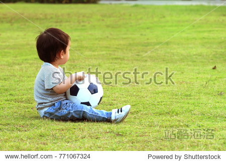 asianboynation_toddler asian boy play in the yard or lawn or football field.