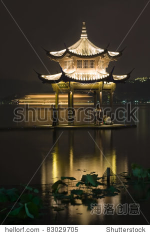 Long exposure image of Xihu Lake at night, Hangzhou, China, Asia. Ship in motion on the background.