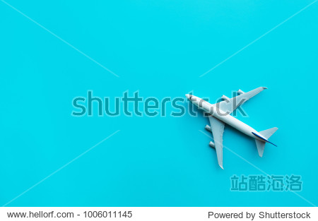 Model plane airplane on blue pastel color background.