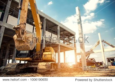 construction equipment in construction new warehouse background