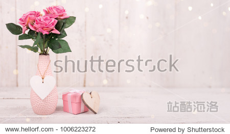 Flowers composition for Valentine's  Mother's or Women's Day. Pink flowers on old white wooden background. Still-life.