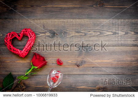 Celebrate Valentine's day. Wine glasses  red rose  heart sign on dark wooden background top view copy space