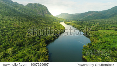 Beautiful natural scenery of river in southeast Asia tropical green forest  with mountains in background  aerial view drone shot