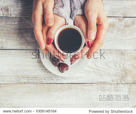 A cup of coffee in the hands of lovers. Selective focus.