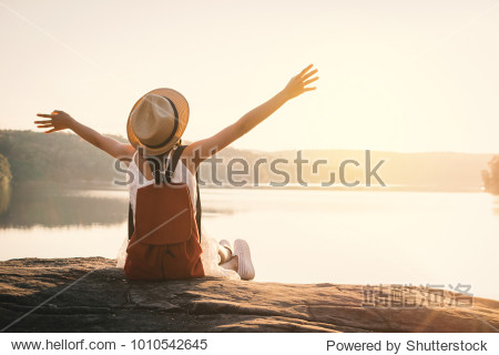 Asian girl backpack in nature during sunset , Relax time on holiday concept travel,selective and soft focus,color tone of hipster style