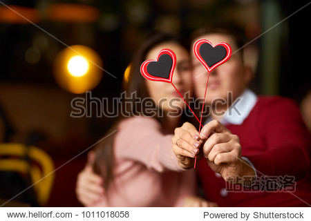 Valentine's Day concept. Happy couple in love with. A young loving couple celebrating Valentine's Day in the restaurant. Lovers give each other gifts. Romance restaurant for Valentine's Day- concept