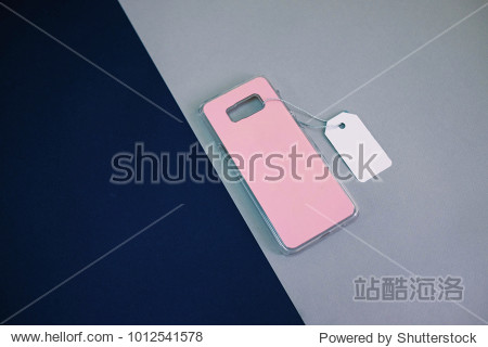 Pink plastic cover for mobile phone with price tag on modern background  copy space  sale space for your branding design  corporate identity