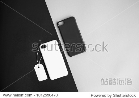 Black and white concept : Top view of mock up clear phone case black and white color with price tag on basic black white background  copy space  branding  corporate