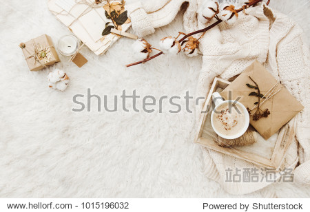 Winter cozy background with cup of coffee  warm sweater and old letters. Flat lay for bloggers